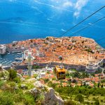 Old town of Dubrovnik with cable car ascending Srd mountain, Dal